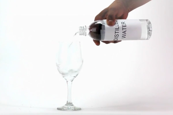 Distilled bottled Water poured into glass